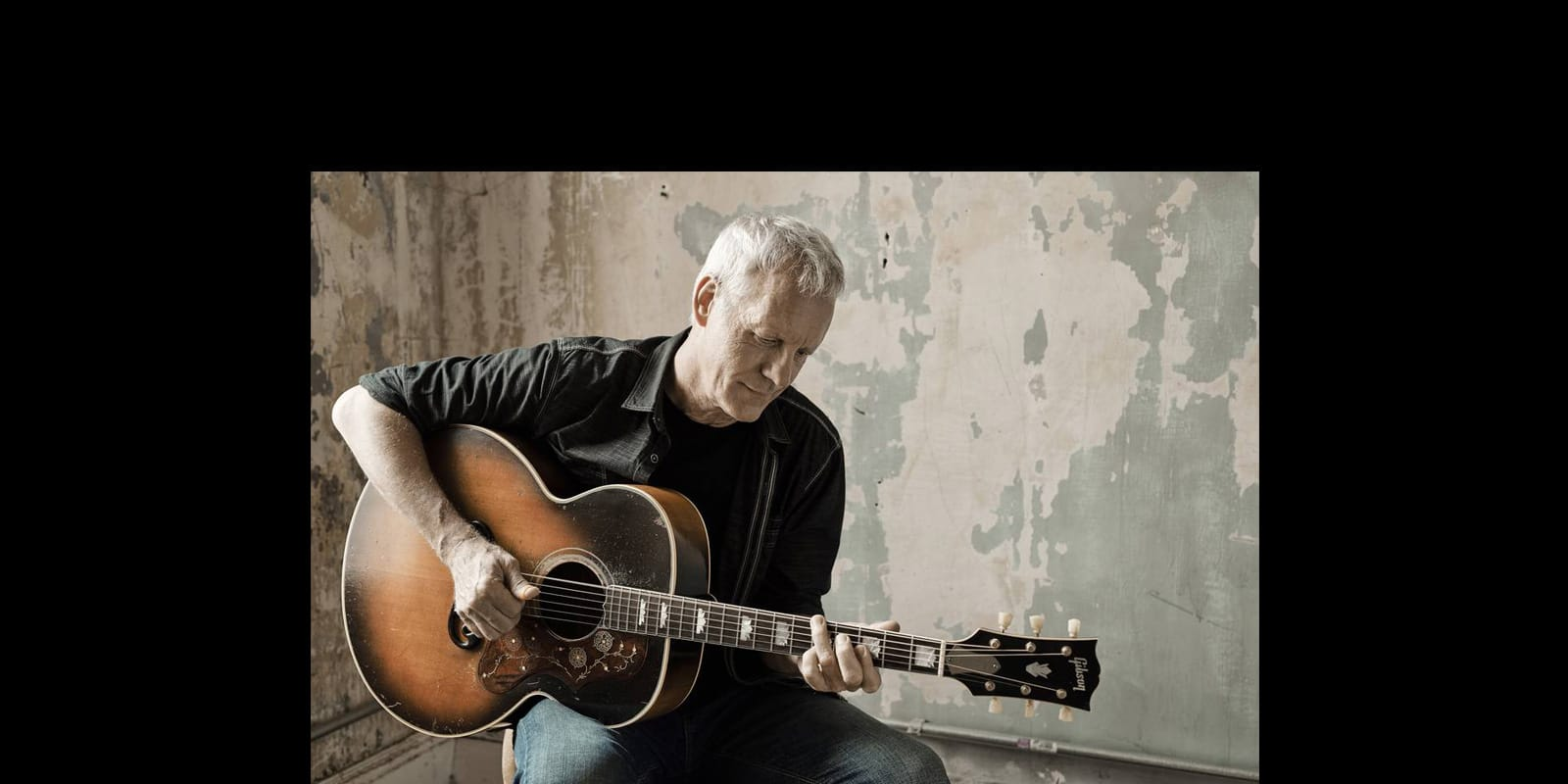 Rod Abernethy playing guitar