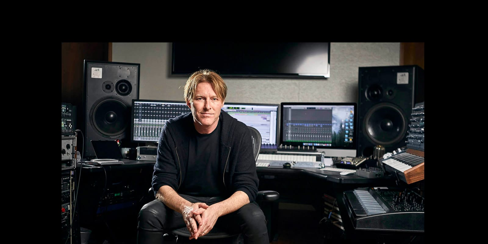 Tyler Bates in his studio with ATC monitors